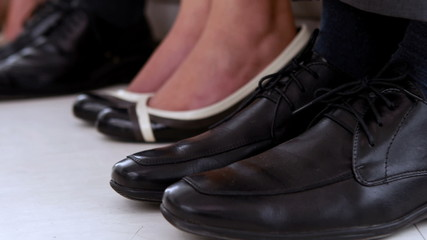 Business people shaking feet nervously waiting for interview