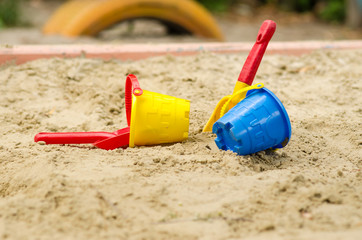 Toy bucket and shovel in the sandbox