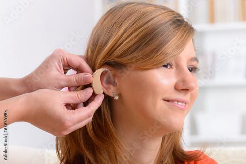 Woman wearing deaf aid - 67635985