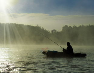 In the morning mist on fishing