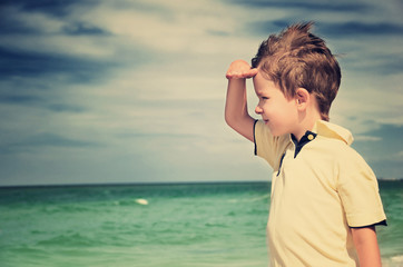 toned image boy looking away from his palm on the background of
