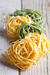 yellow and green uncooked pasta tagliatelle