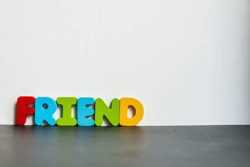 Colorful wooden word Friend with white background