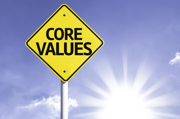 Core Values road sign with sun background