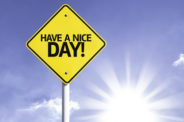 Have a Nice Day road sign with sun background
