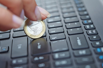 coin on laptop