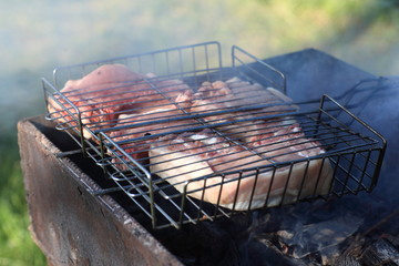 Pork chops on barbecue grill