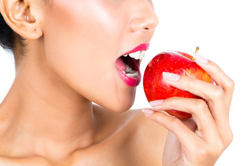 Asian woman eating apple and living healthy