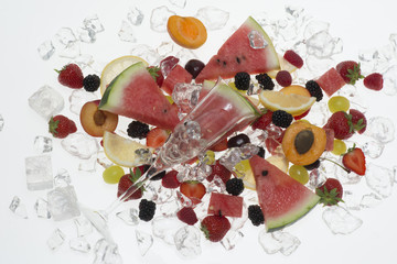 glass of wine with fruit on white background