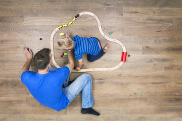 Father and son playing with a train set
