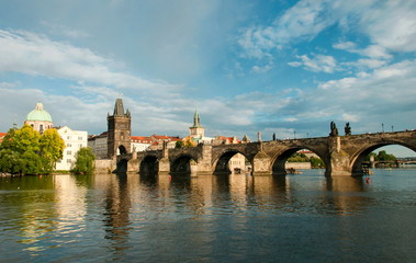 Old bridge across the wide river. Prague