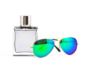 Perfume and sunglass on white background