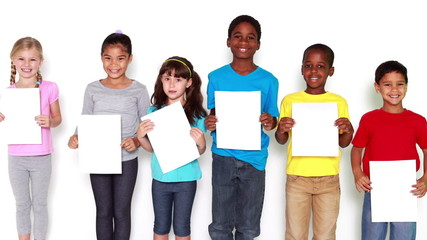 Cute little children covering face with white paper