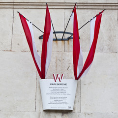 Four Austrian flags on the wall of St. Charles's Church, Vienna