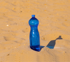 Bottle of water in a dune