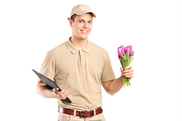 Delivery guy holding a bunch of flowers and a clipboard