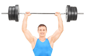 Male athlete holding a heavy weight