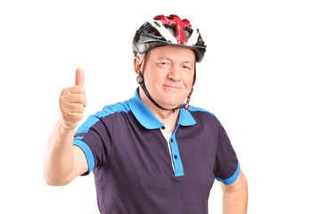 Mature man with a sports helmet giving a thumb up