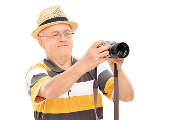 Mature man taking a picture with camera