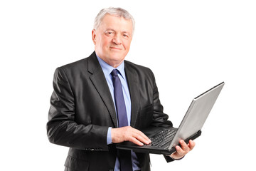 Mature manager working on a laptop