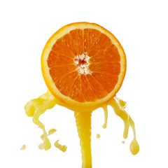 orange juice splashing on a white background