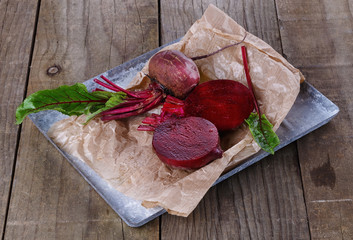 Organic beetroot on a rustic wooden background