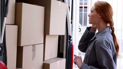 Delivery driver checking her load in the van