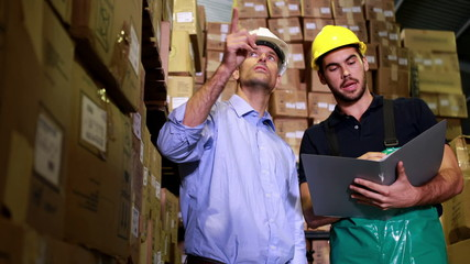 Warehouse manager speaking with foreman