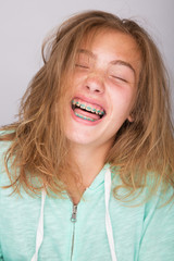 Girl laughing with braces