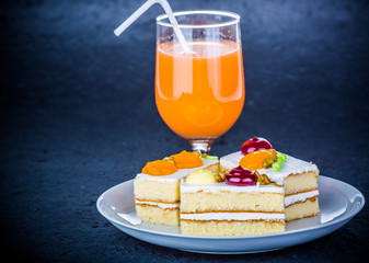 cake with juice on white plate, blue background