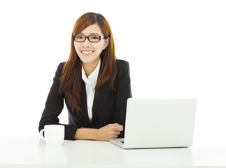 young confident business woman sitting with laptop