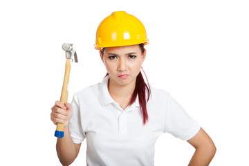 Angry Asian engineer girl hold a hammer