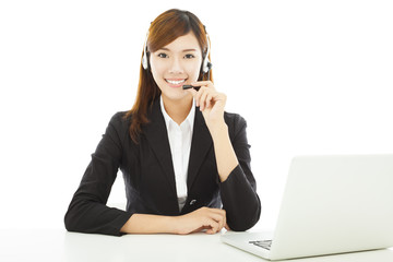Young professional business woman with earphone and laptop