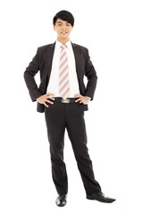 young businessman standing and hands on waist.