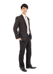 young businessman standing and hands on pocket. isolated on whit