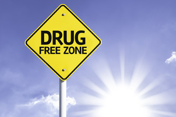 Drug Free Zone road sign with sun background