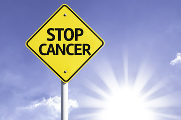 Stop Cancer road sign with sun background
