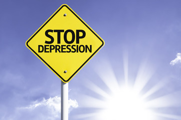 Stop Depression road sign with sun background