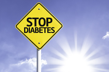 Stop Diabetes road sign with sun background