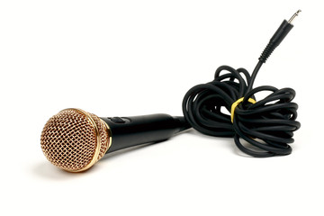 golden microphone isolated on white background