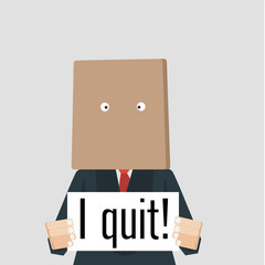 "Businessman with bag over his head holding card ""I quit."""
