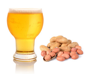 Glass of light beer and peanuts isolated on white