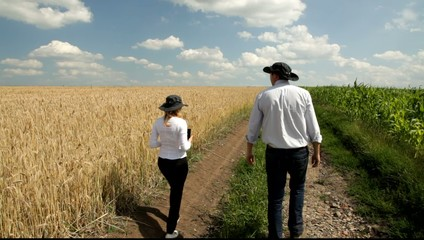 Woman and man looking at the fields