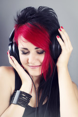 Beautiful girl with headphones enjoying listening to the music