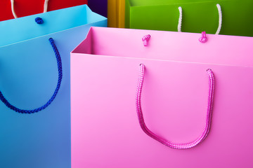 Colorful paper shopping bags with copy space.