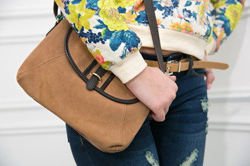 girl holding a bag. closeup