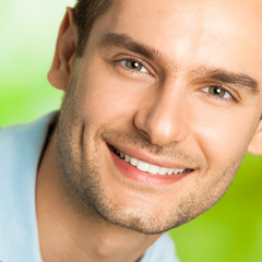 Portrait of young happy smiling man