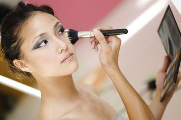 Beauty makeup woman applying make up