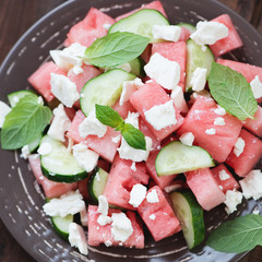Salad with watermelon cubes, cucumber slices, cheese and mint