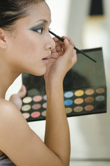 Beauty makeup woman applying make up